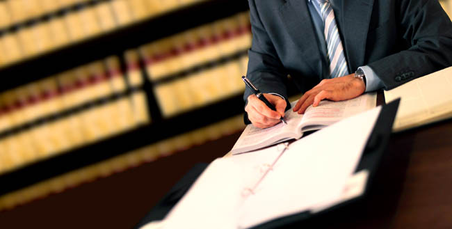 businessman signing acontract